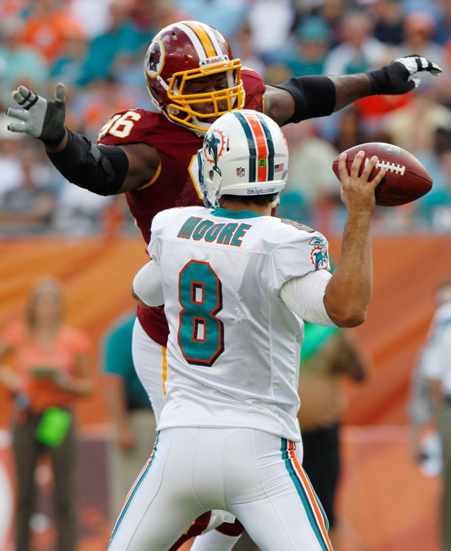 Washington Redskins nose tackle Barry Cofield (96) pressures Miami Dolphins quarterback Matt Moore (8) during the first quarter. (AP Photo/Hans Deryk)