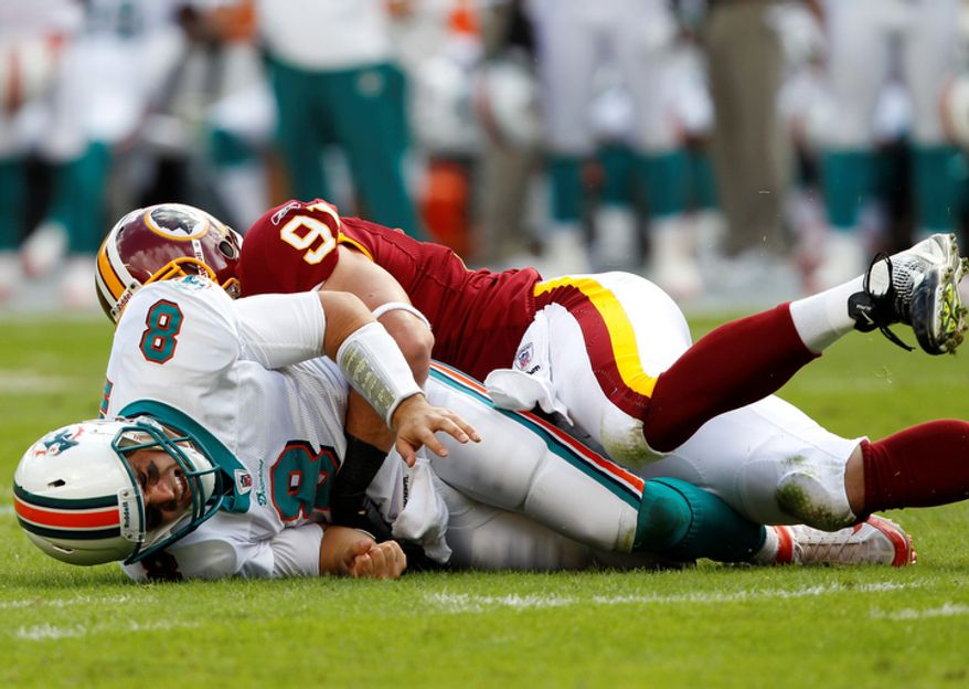 Miami Dolphins quarterback Matt Moore (8) is sacked by Washington Redskins outside linebacker Ryan Kerrigan (91) in the first quarter. (AP Photo/Hans Deryk)