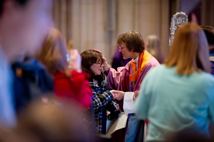 The Reverend Dr. Mariann Edgar Buddle, right, the newly seated ninth bishop of Washington, greets a member of the congregation following the service of Holy Eucharist. (Andrew Harnik / The Washington Times)