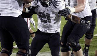 Oregon running back LaMichael James is congratulated after scoring against Stanford in the fourth quarter in Stanford, Calif., Saturday, Nov. 12, 2011. (AP Photo/Paul Sakuma)