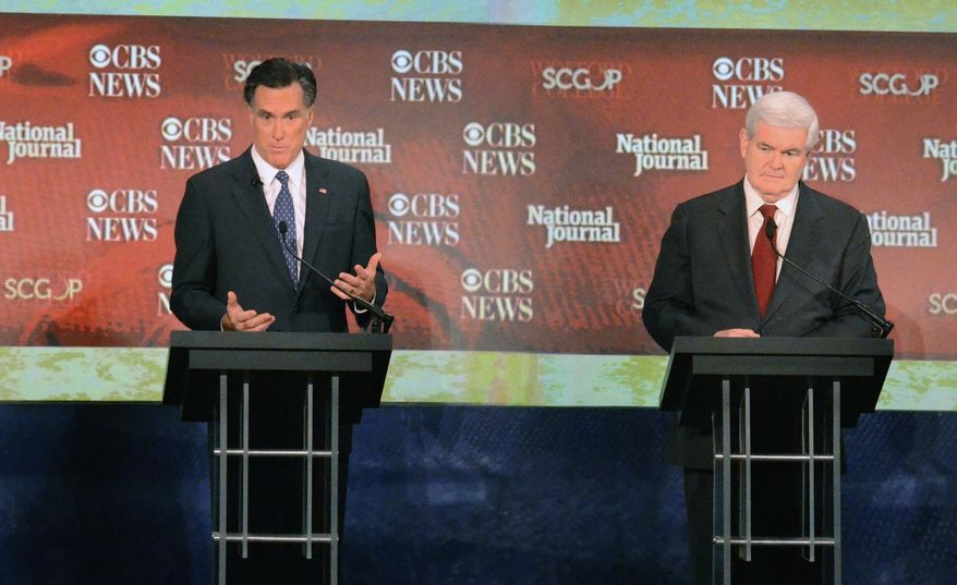 Republican presidential candidates Newt Gingrich (right) and former Massachusetts Gov. Mitt Romney participate in the CBS News/National Journal foreign policy debate at the Benjamin Johnson Arena in Spartanburg, S.C., on Nov. 12, 2011. (Associated Press)