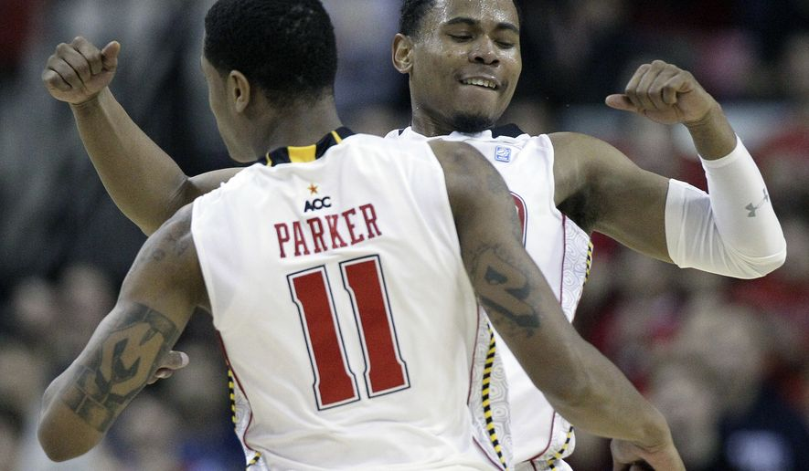 Maryland guard Terrell Stoglin and forward Mychal Parker celebrate after scoring against UNC Wilmington in the first half in College Park, Md., Sunday, Nov. 13, 2011. Stoglin scored a team-high 22 points - and Parker had five points and three rebounds - in Maryland's 71-62 win. (AP Photo/Patrick Semansky)
