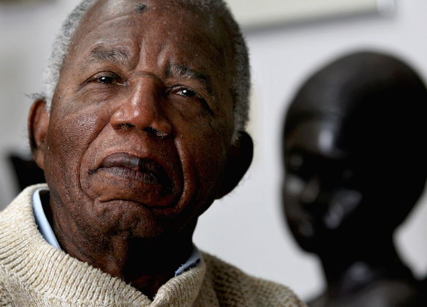 Chinua Achebe, a Nigerian-born novelist and poet, is viewed by many as a pre-eminent voice of dissent and conscience in his native country, from which he has again turned down a national honor. (Associated Press)
