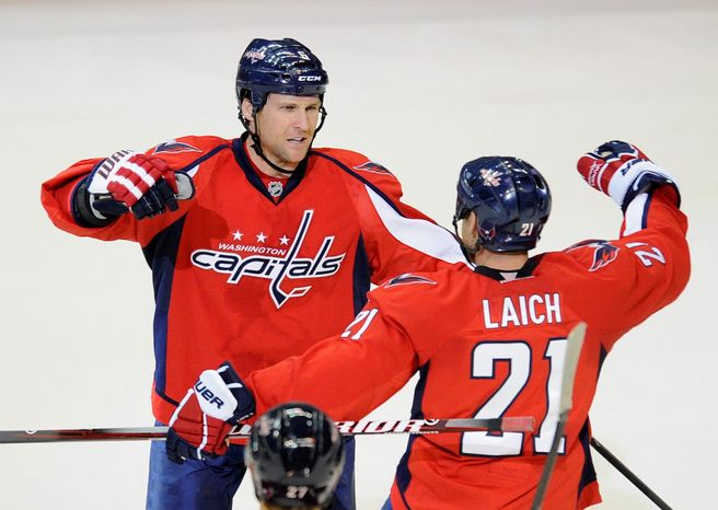 Because of assorted ailments to Capitals defensemen, Dennis Wideman (left) has been playing more minutes and forward Brooks Laich has spent time on the blue line. (Associated Press)
