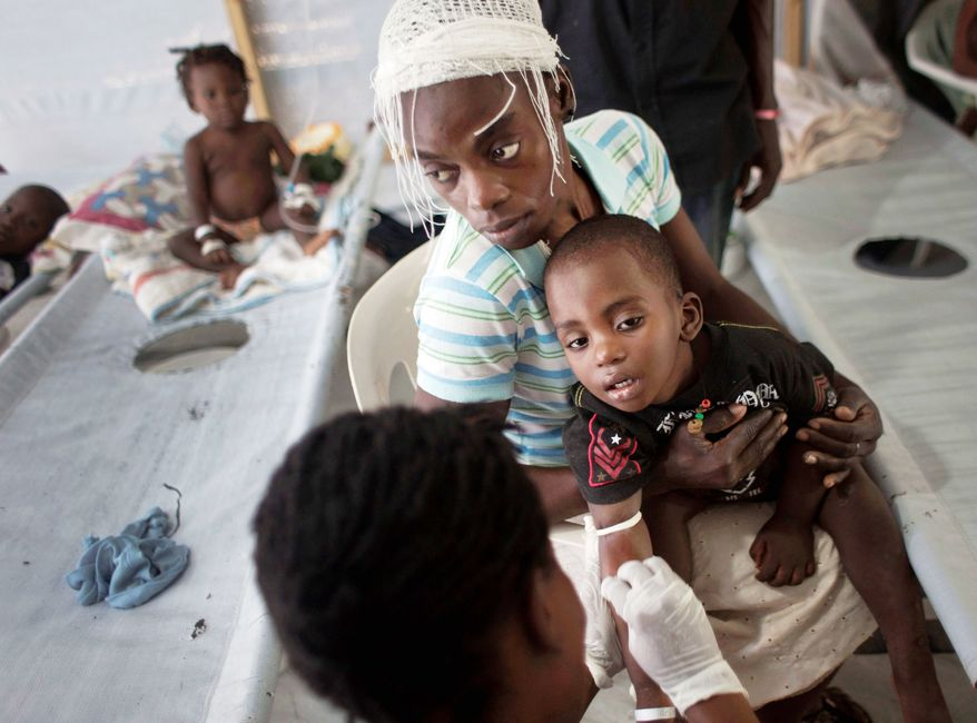 A child is treated for cholera in October at a Doctors Without Borders clinic in Port-au-Prince, Haiti. (Associated Press)