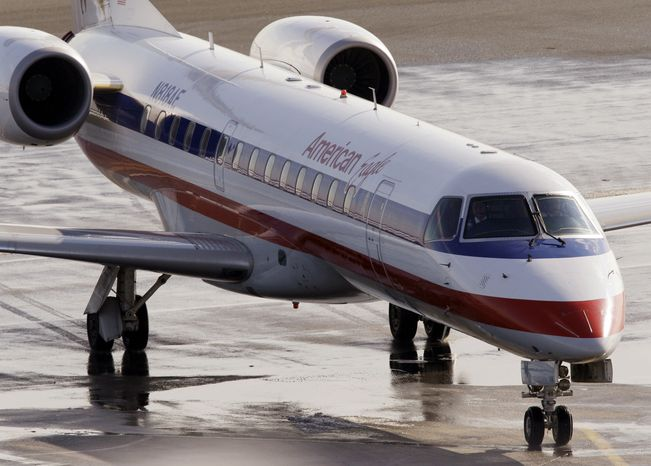 **FILE** An American Eagle jet taxis at Boston's Logan International Airport on Jan. 20, 2011. (Associated Press)