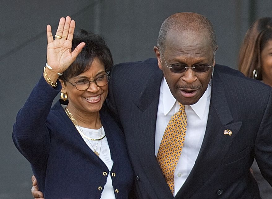 **FILE** Gloria Cain (left) accompanies her husband, Republican presidential candidate Herman Cain, as he announces his candidacy in Atlanta on May 21, 2011. (Associated Press)