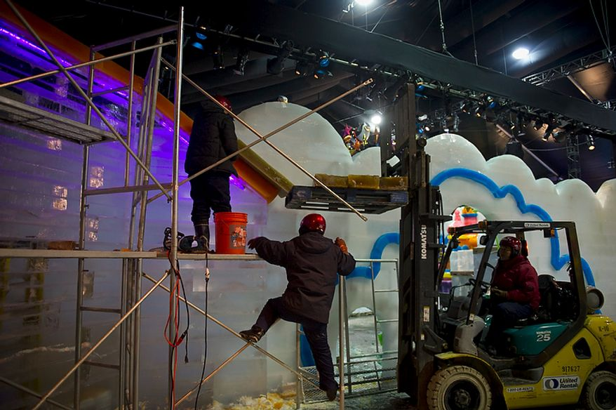 """Artisan ice sculptors from Harbin, China work to create colorful scenes from the DreamWorks' production of """"Merry Madagascar"""" for this years ICE! show in Oxon Hill, Md, Thursday, November 9, 2011. (Rod Lamkey Jr. / The Washington Times)"""