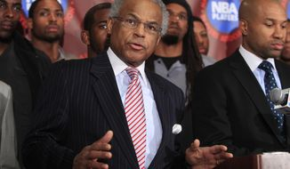 **FILE** Union executive director Billy Hunter speaks Nov. 8, 2011, during a news conference in New York as Player's association president Derek Fisher (right) and other NBA players look on. (Associated Press)