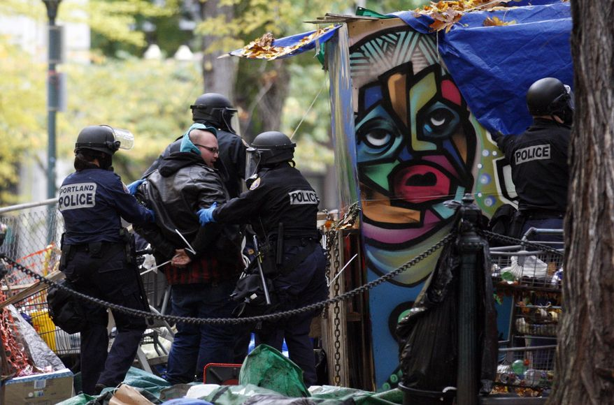 Police officers arrests a protester in the Occupy Portland encampment on Nov. 13, 2011, in, Portland, Ore. (Associated Press)