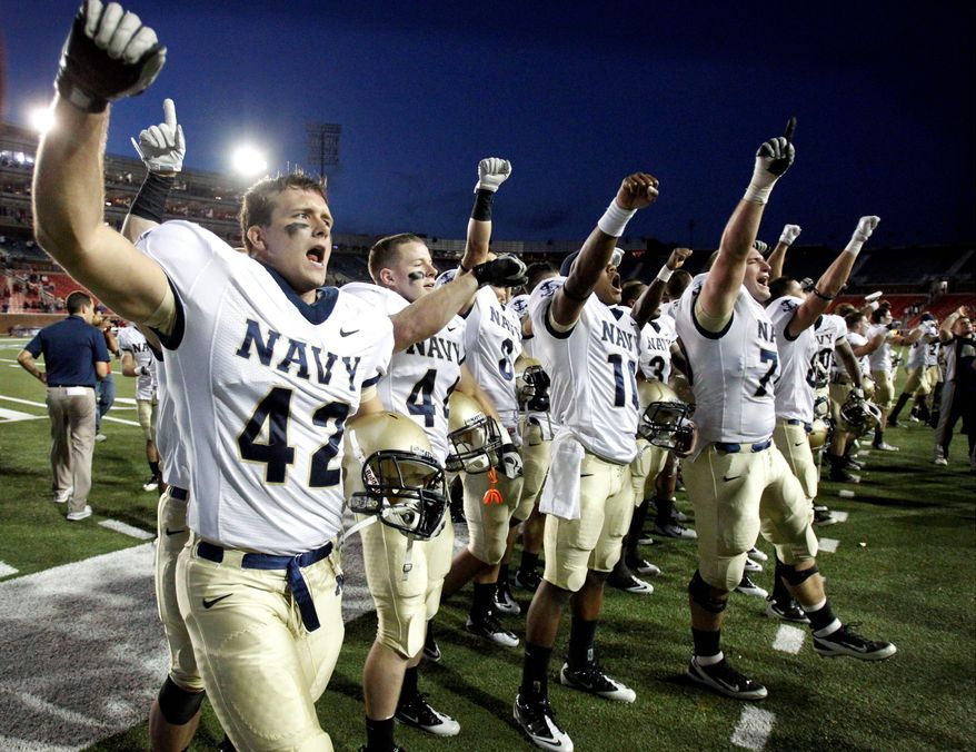 Mason Graham (42) celebrates with teammates after Navy's 24-17 victory over SMU on Saturday. The Midshipmen can clinch a trip to the Military Bowl with two more wins. (Associated Press)
