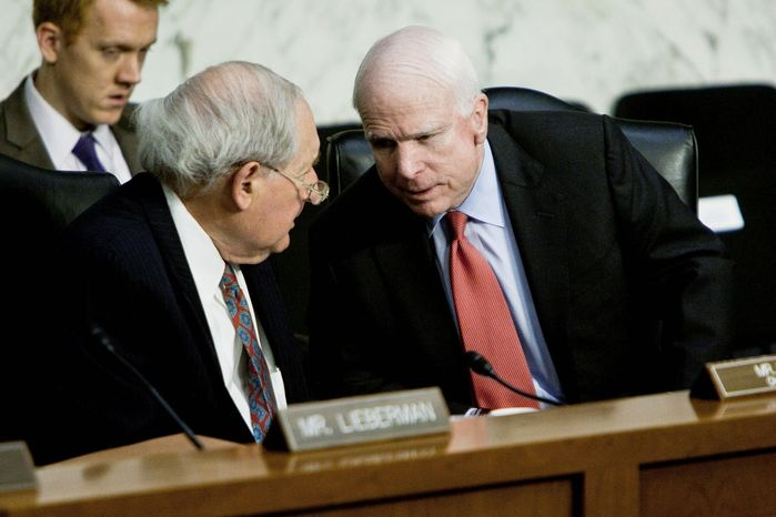 ** FILE ** Sen. Carl Levin (left), Michigan Democrat, chats with Sen. John McCain, Arizona Republican, during a hearing of the Senate Armed Services Committee on Tuesday, Nov. 15, 2011. (T.J. Kirkpatrick/The Washington Times)