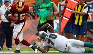 Redskins running back Ryan Torain eluded Dolphins defensive end on this play, but Torain managed just 20 yards on 11 carries in the 20-9 loss. (Associated Press)