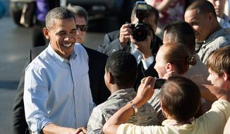 President Obama greets a crowd at Joint Base Pearl Harbor-Hickam Field in Honolulu on Tuesday before flying to Australia. Republicans are chiding the president for the time he's spending abroad as a budget deadline nears. (Associated Press)