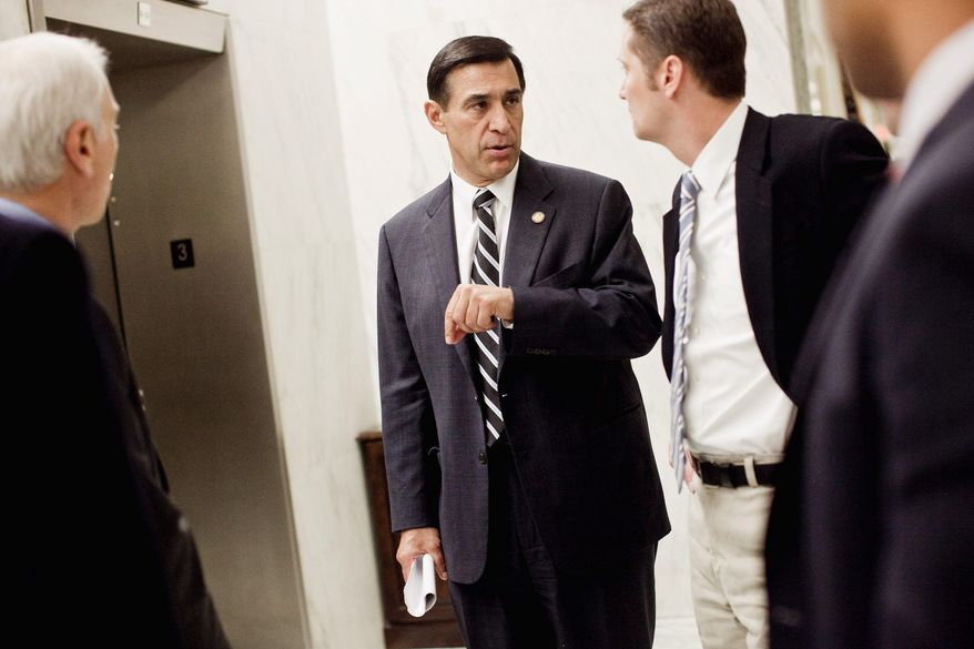 Rep. Darrell Issa (R-Calif.) walks with staff members through the Rayburn House Office Building in Washington, D.C. on Nov. 15, 2011. Issa introduced a bill that would grant the District greater control of its own budget, but that prevents local funds from being used for abortions except in cases of rape, incest or to protect the mother's health. (T.J. Kirkpatrick/ The Washington Times)