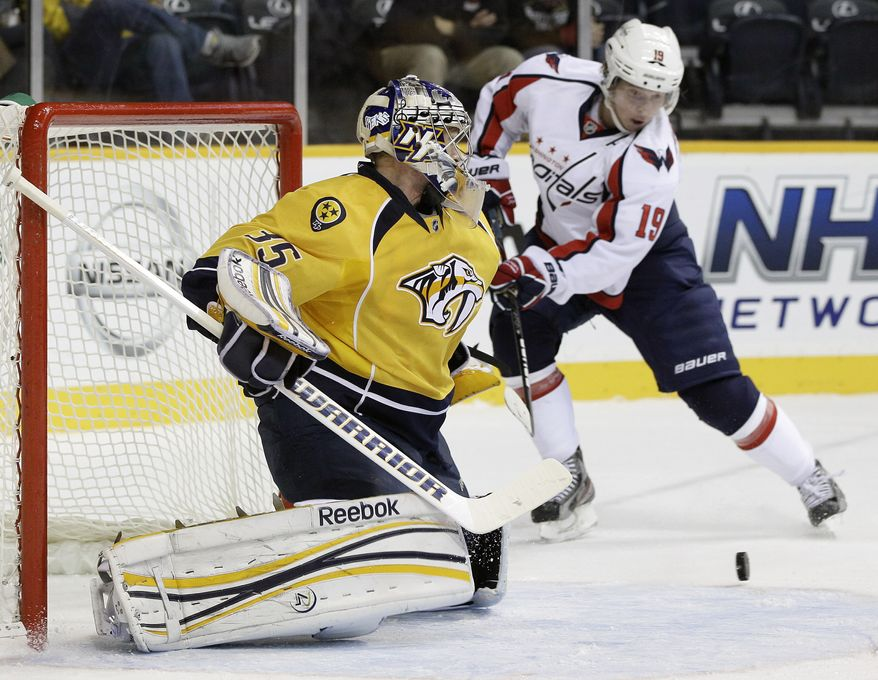 Nashville Predators goalie Pekka Rinne (35) blocks a shot as Washington Capitals center Nicklas Backstrom (19) comes in for the rebound in the first period of an NHL game on Tuesday, Nov. 15, 2011, in Nashville, Tenn. (AP Photo/Mark Humphrey)