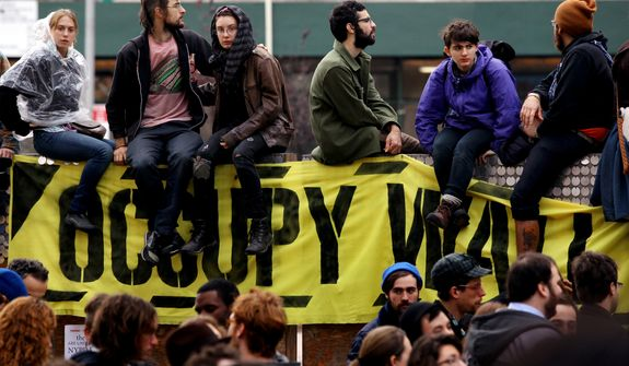 Occupy Wall Street protesters regroup Nov. 15, 2011, in New York's Duarte Park after being forced to leave Zucotti Park earlier that day. (Associated Press)