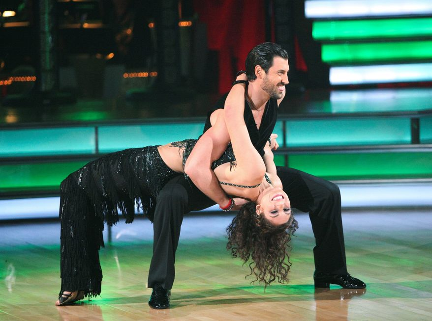 """In this Nov. 14, 2011 image released by ABC, soccer player Hope Solo and her partner Maksim Chmerkovskiy perform on the celebrity dance competition series """"Dancing with the Stars,"""" in Los Angeles. (AP Photo/ABC, Adam Taylor)"""