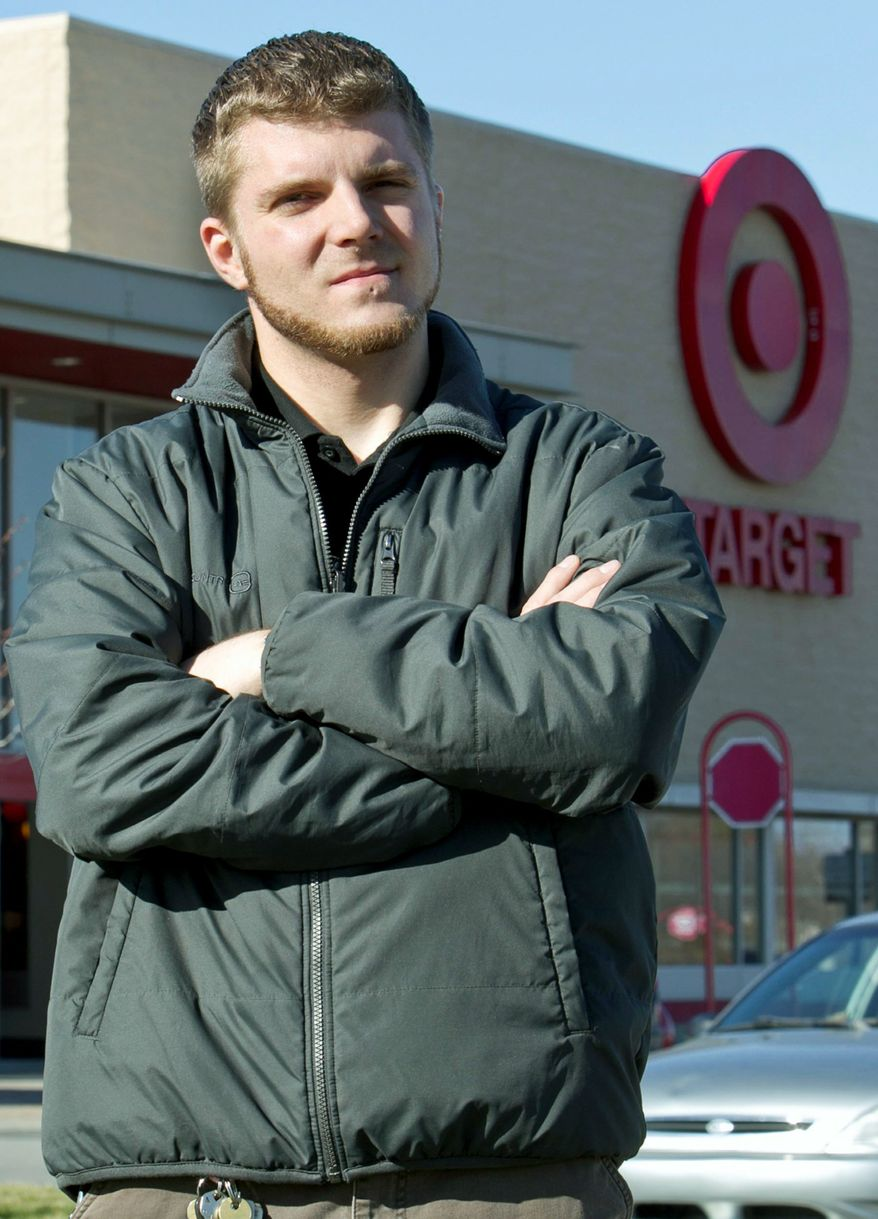 Anthony Hardwick, a part-time worker at a Target store in Nebraska, is petitioning against a planned midnight Black Friday opening of Target stores. (Associated Press)
