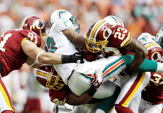 Washington's run defense, which allowed Miami 3.1 yards per rush last week, faces a stiff challenge Sunday when Dallas and rookie DeMarco Murray pay a visit. (Associated Press)