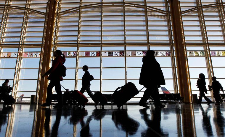 """A new survey of nearly 4,400 U.S. air travelers, such as these at Ronald Reagan Washington National Airport, found that most named """"people who bring too many carry-on bags through the security checkpoint"""" as their top frustration. (Associated Press)"""