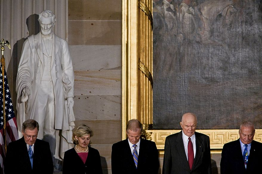 From left: Senate Minority Leader Mitch McConnell, Kentucky Republican; Sen. Kay Bailey Hutchison, Texas Republican; former astronaut Sen. Bill Nelson, Florida Democrat; and astronauts John Glenn and Buzz Aldrin stand under a statue of Abraham Lincoln on Nov. 16, 2011, during the invocation of a Congressional Gold Medal ceremony at the Capitol building in Washington. (T.J. Kirkpatrick/The Washington Times)