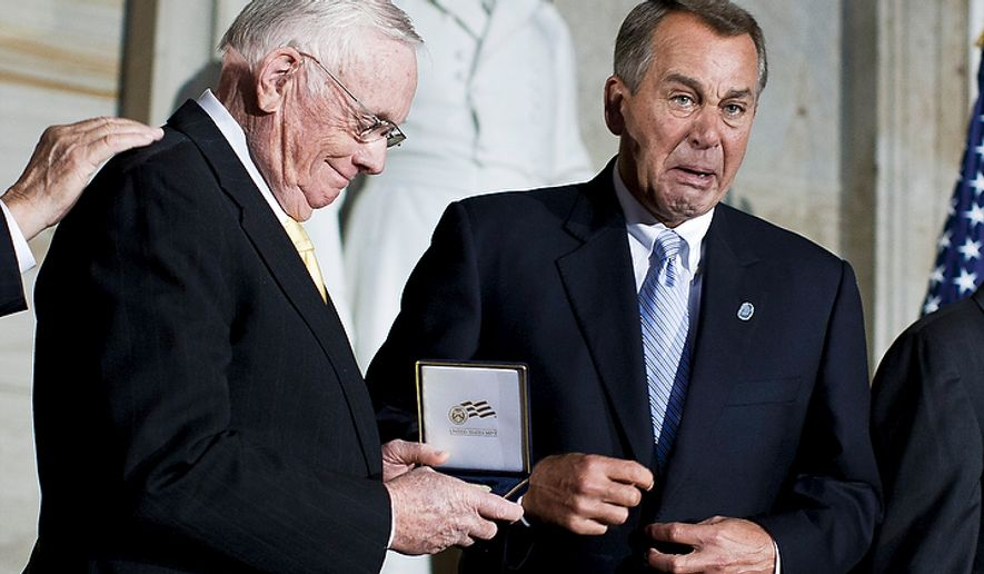 House Speaker John Boehner (right), Ohio Republican, reacts emotionally while presenting a Congressional Gold Medal to astronaut Neil Armstrong during a ceremony in honor of Armstrong and fellow astronauts Michael Collins, John Glenn and Buzz Aldrin at the Capitol building in Washington on Nov. 16, 2011. (T.J. Kirkpatrick/The Washington Times)