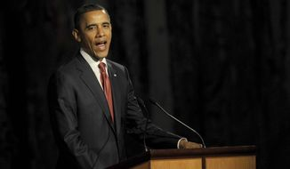 U.S. President Barack Obama speaks at a parliamentary dinner in Canberra, Australia, Wednesday, Nov. 16, 2011. (AP Photo/Alan Porritt, Pool)