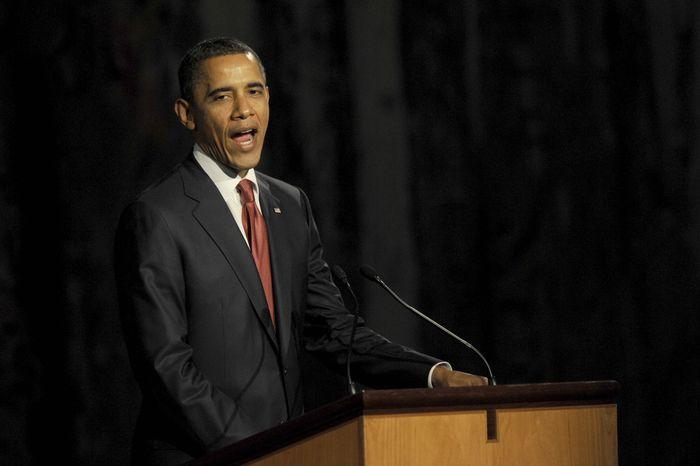 U.S. President Barack Obama speaks at a parliamentary dinner in Canberra, Australia, Wednesday, Nov. 16, 2011. (AP Photo/Alan Porritt, Pool)