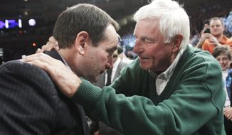 Duke coach Mike Krzyzewski, left, talks with Bob Knight after Duke defeated Michigan State 74-69 in an NCAA college basketball game Tuesday, Nov. 15, 2011, in New York. Krzyzewski earned his 903rd win, passing Knight for the most Division I men's victories. (AP Photo/Kathy Willens)