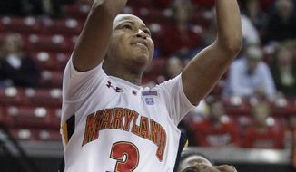 Maryland guard Brene Moseley (3) shoots over Towson guard Tanisha McTiller in the second half in College Park, Md., Wednesday, Nov. 16, 2011. Moseley contributed a game-high 26 points to Maryland's 82-46 win. (AP Photo/Patrick Semansky)