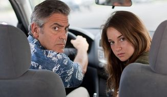"George Clooney has taken a back seat in parenting until his wife is hospitalized in ""The Descendants."" His older daughter, played by Shailene Woodley, has had a difficult relationship with her mom and reveals a family secret. (Searchlight Films via Associated Press)"