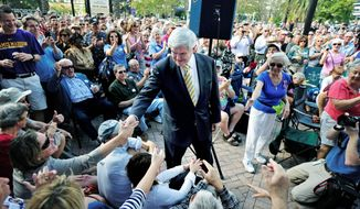 "CROWD PLEASER: GOP presidential hopeful Newt Gingrich presses the flesh Thursday in Jacksonville, Fla. ""The surge of support for me is a result of a steady focus on substance, on large-solution proposals,"" he says. (Associated Press)"
