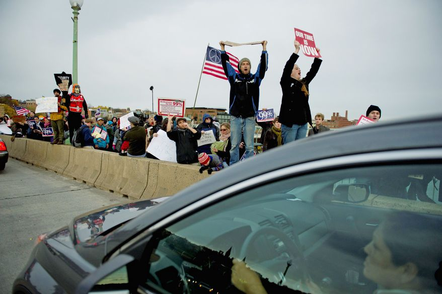 Occupy D.C. demonstrators took to the Francis Scott Key Bridge on Thursday as encampments across the country commemorated two months passing since the movement began. The protesters hoped to encourage Congress to consider reinvesting in the country's infrastructure. (Rod Lamkey Jr./The Washington Times)