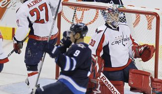 Winnipeg Jets celebrate after Evander Kane scores his second goal of the game against the Washington Capitals during the second period at MTS Centre in Winnipeg, Manitoba, Thursday, Nov. 17, 2011. The Jets won 4-1. (AP Photo/The Canadian Press, Trevor Hagan)
