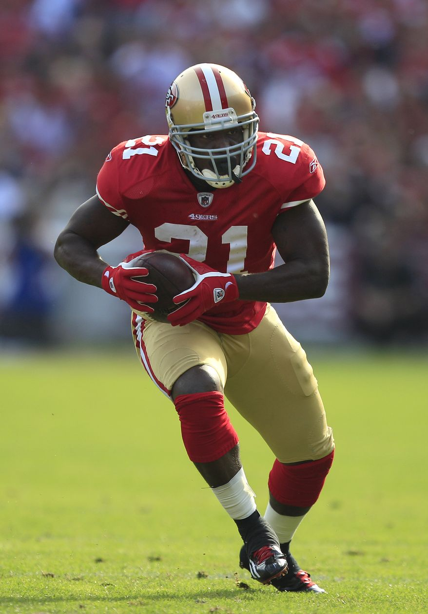 San Francisco 49ers running back Frank Gore (21) runs against the New York Giants in the first quarter of an NFL football game in San Francisco, Sunday, Nov. 13, 2011. (AP Photo/Marcio Jose Sanchez)