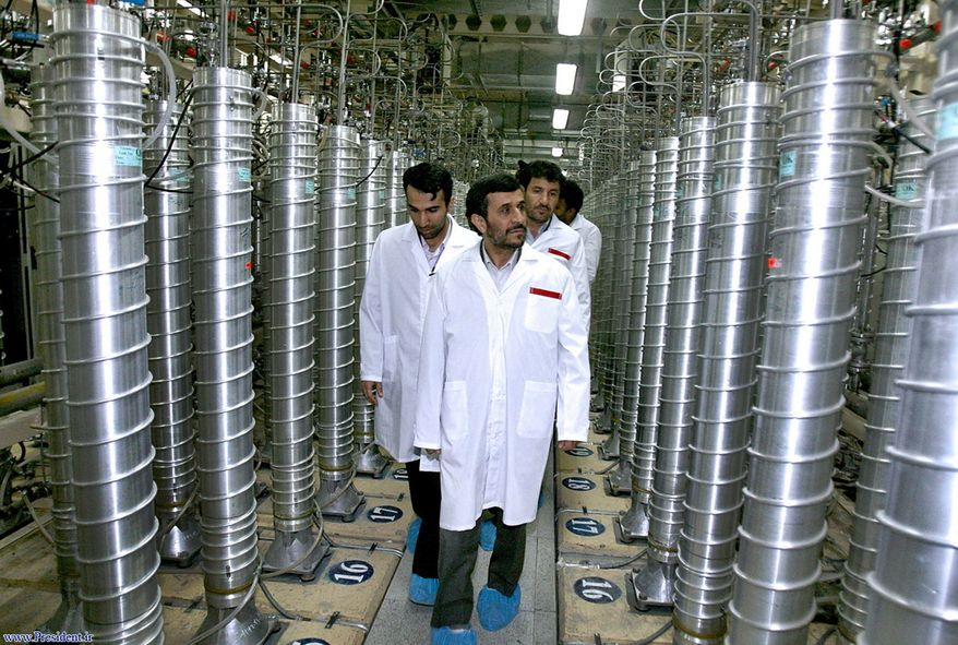 ** FILE ** In this Tuesday, April 8, 2008, file photo released by the Iranian President's Office, Iranian President Mahmoud Ahmadinejad, center, visits the Natanz Uranium Enrichment Facility some 200 miles (322 kilometers) south of the capital Tehran, Iran. (AP Photo/Iranian President's Office, File)