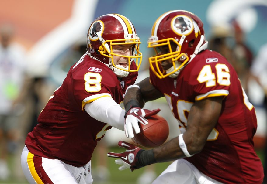 Washington Redskins quarterback Rex Grossman (8) hands off the football to running back Ryan Torain (46) during the first quarter of an NFL football game against the Miami Dolphins, Sunday, Nov. 13, 2011, in Miami. (AP Photo/Lynne Sladky)