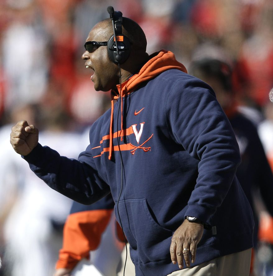 Virginia coach Mike London led his team to an 8-4 record an spot in the Chick-fil-A Bowl against Auburn. (AP Photo/Patrick Semansky)