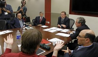 Grover Norquist, president of a taxpayer advocacy group, Americans for Tax Reform, center, meets with a group of millionaires discuss issues related to the debt supercommittee, Wednesday, Nov. 16, 2011, in Washington. (AP Photo/Haraz N. Ghanbari)
