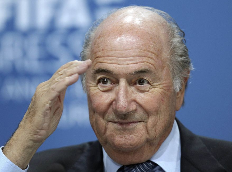 **FILE** Swiss FIFA President Sepp Blatter reacts June 1, 2011, during a press conference after the 61st FIFA Congress in Zurich, Switzerland. (Associated Press)