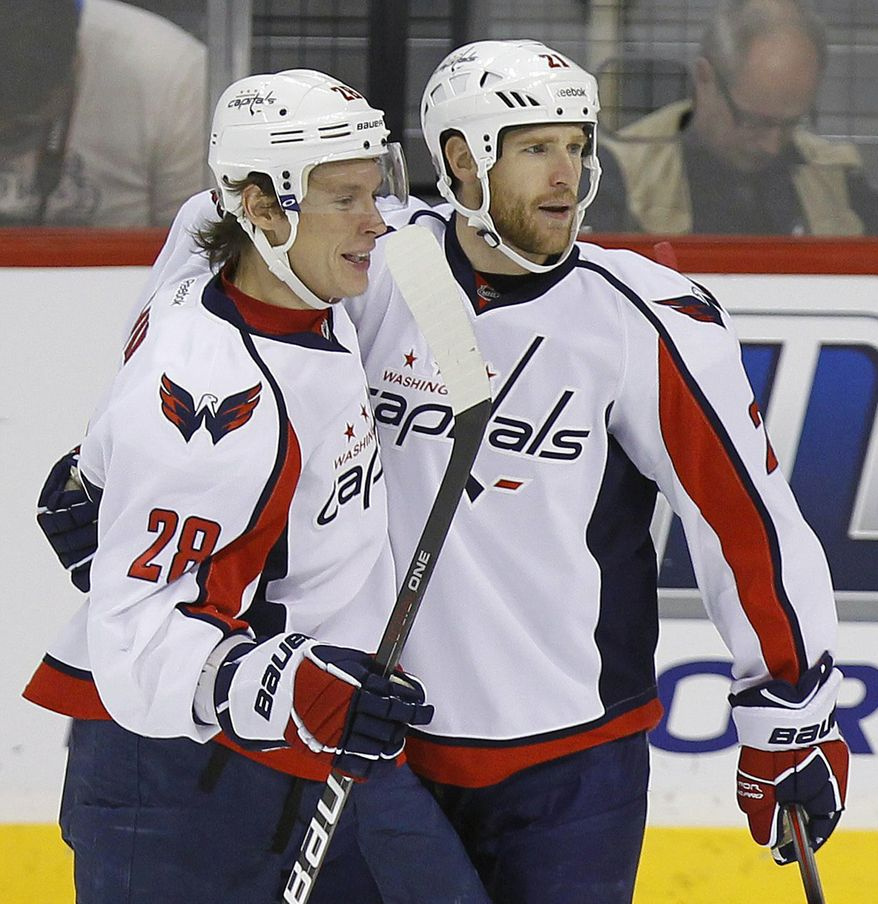 Washington Capitals forward Brooks Laich is confident that the team will make the playoffs. The Capitals have two games remaining in their season and are currently tied with the Buffalo Sabres for the final playoff spot in the Eastern Conference. (AP Photo/The Canadian Press, Trevor Hagan)