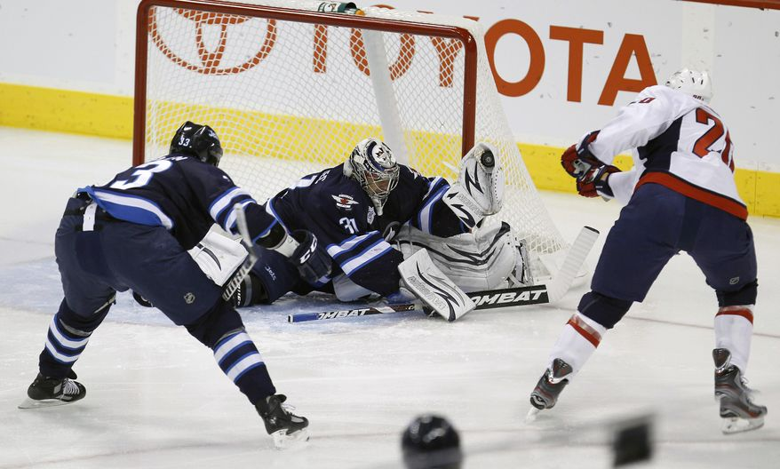 Washington Capitals' Troy Brouwer has received just over two minutes of power play time a game, yet has no points to show for it. The Caps' success rate on the man advantage has fallen to 10th in the league, and it's coincided with the loss of defenseman Mike Green.  (AP Photo/The Canadian Press, Trevor Hagan)
