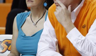 This Nov. 9, 2011 photo shows Oklahoman State women's basketball coach Kurt Budke and assistant coach Miranda Serna during an an exhibition women's NCAA college basketball game against Fort Hays State, in Stillwater, Okla. Budke and Serna were killed when the single-engine plane they were riding in during a recruiting trip crashed near a wildlife management area in central Arkansas. The university said the pair died in the crash Thursday night, Nov. 17, 2011. (AP Photo/The Oklahoman, Bryan Terry)