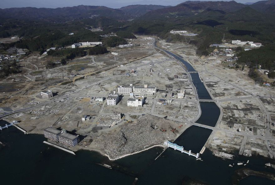 The town of Minamisanriku is seen eight months after it was destroyed by the March 11 tsunami, in northeast Japan, Friday, Nov. 18, 2011. (AP Photo/Greg Baker)