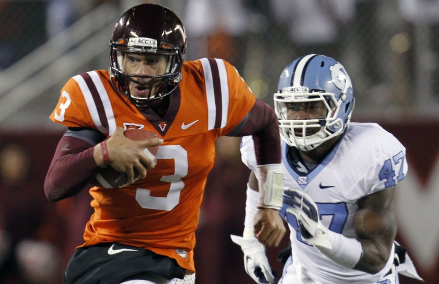 Virginia Tech quarterback Logan Thomas threw for two touchdowns on 195 yards and ran for another as Tech held on for a 24-21 win against North Carolina on Thursday night. (AP Photo/Steve Helber)