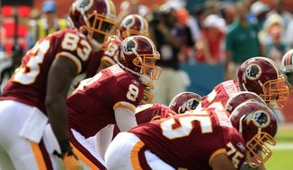 The Washington Redskins' already-patchwork offensive line may be reshuffled yet again as right tackle Jammal Brown is dealing with a left groin injury and backup Sean Lockelar (shown, No. 75) is suffering from an ankle injury. Undrafted rookie Willie smith might get the start. Tyler Polumbus will also get the start in place of Maurice Hurt, who has a knee injury. (AP Photo/Wilfredo Lee)