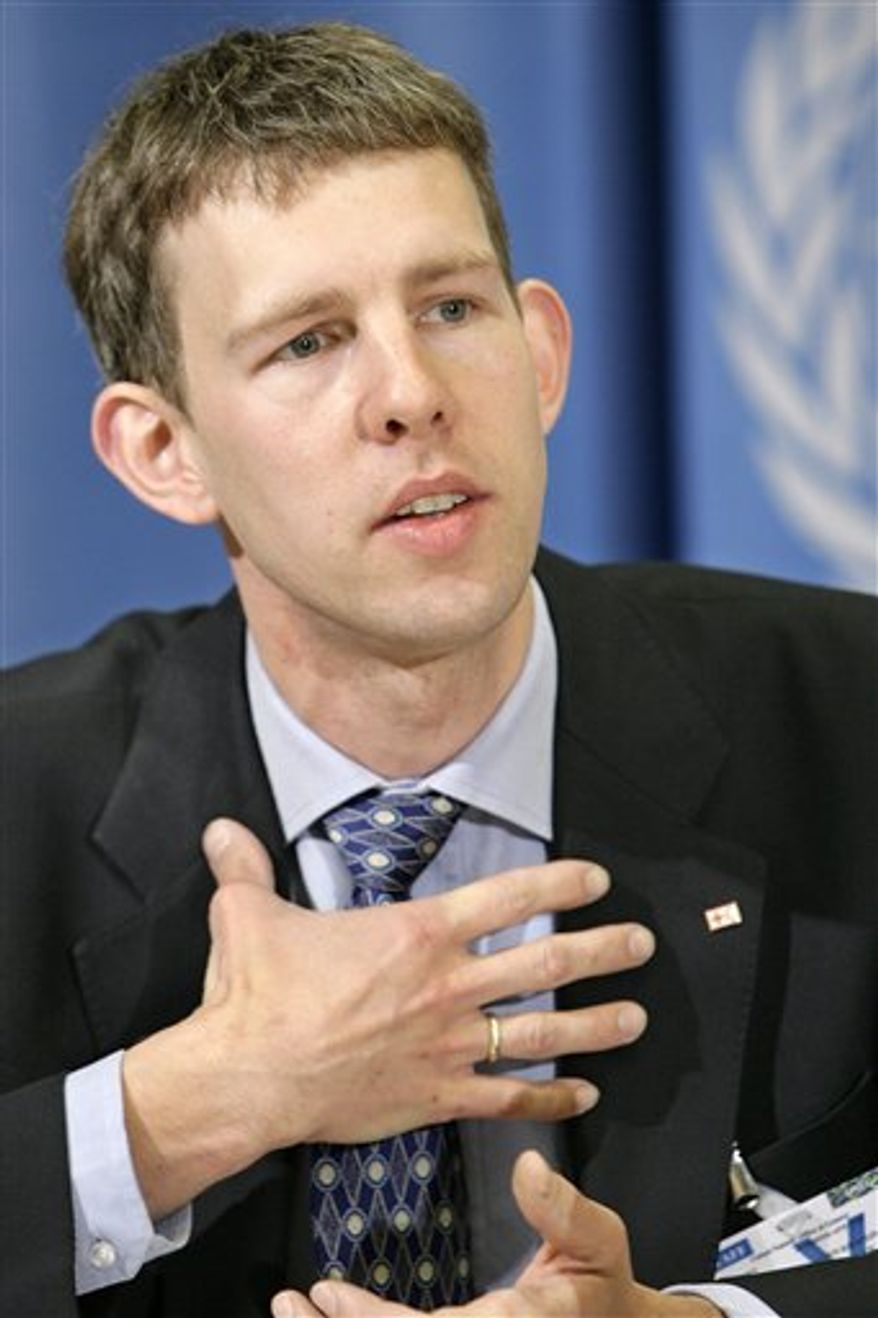 "Maarten van Aalst, leading climate specialist for the Red Cross and Red Crescent, speaks about how climate change will affect people and assets during the presentation of the Intergovernmental Panel on Climate Change (IPCC) report at a press conference at the European headquarters of the United Nations in Geneva, Switzerland, in this April 11, 2007 file photo. Top international climate scientists and disaster experts meeting in Africa had a sharp message Friday Nov. 18, 2011 for the world's political leaders: Get ready for more dangerous and ""unprecedented extreme weather"" caused by global warming. (AP Photo/Keystone, Salvatore Di Nolfi, File)"