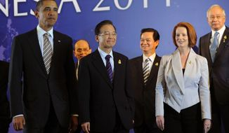 **FILE** Attendees at the Retreat Session of the East Asia Summit in Nusa Dua, Bali, Indonesia, on Nov. 19, 2011, include (from left) U.S. President Barack Obama, Myanmar President Thein Sein (rear), Chinese Premier Wen Jiabao, Vietnamese President Nguyen Tan Dung, Australian Prime Minister Julia Gillard and Malaysian Prime Minister Najib Razak. (Associated Press)