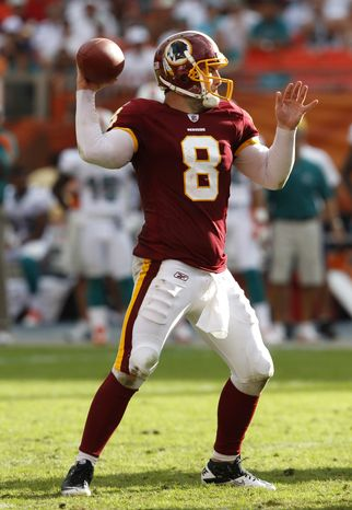 Washington Redskins quarterback Rex Grossman has thrown for 1,347 yards, six touchdowns and 11 interceptions this season, and is being given a second shot at leading the offense. Coaches were happy with his play against the Miami Dolphins last week --- 21 of 32 for 215 yards, no touchdowns --- despite the two picks he threw. Washington will look to snap its five-game losing streak against the Dallas Cowboys on Sunday. (AP Photo/Hans Deryk)